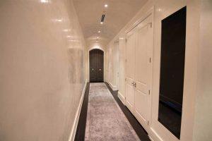 Sleek, built-in av equipment cabinet designed by KINETIQ.tech.
