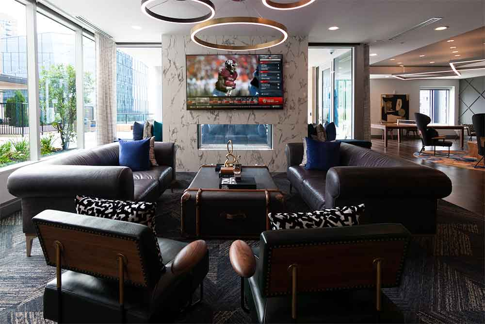 Alexan Atlanta Rec Room Sitting area with indoor fireplace and television monitor